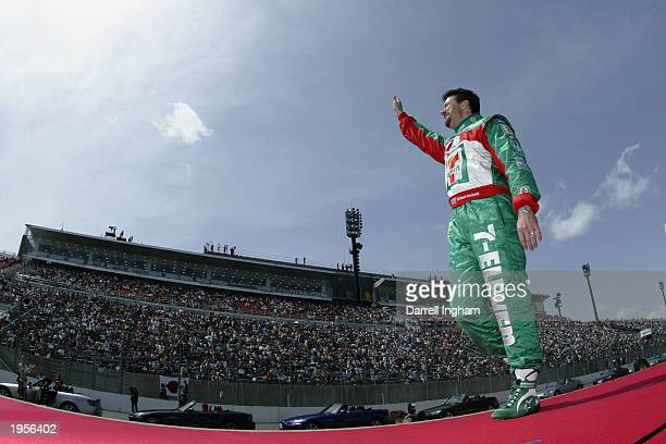 Andretti Green Racing Team 7-Eleven owner and driver Michael Andretti bids farewell to the crowd before his penultimate race at the Indy Japan 300,...