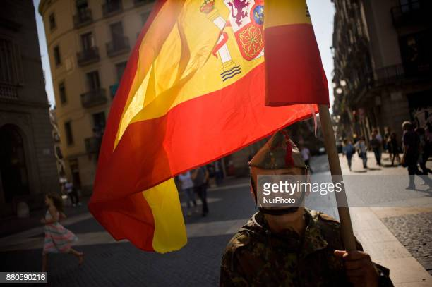 Andreu a former member of La Legion goes on the streets carrying a Spanish flag in occasion of Spain's National Day in Barcelona Spain on 12 October...