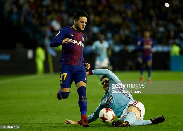 Andreu Fontas of Celta de Vigo competes for the ball with Jose Arnaiz of FC Barcelona during the Copa del Rey Round of 16 first Leg match between...