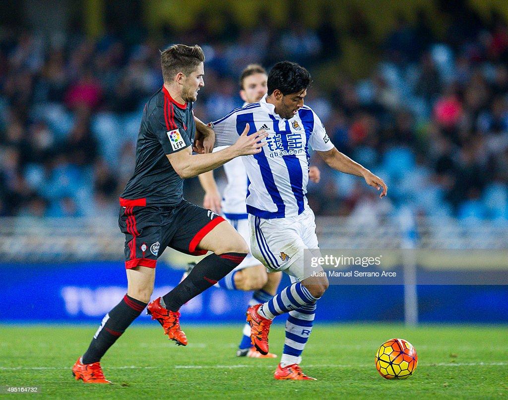 Andreu Fontas of Celta de Vigo duels for the ball with Carlos Vela of Real Sociedad during the La Liga match between Real Sociedad de Futbol and Celta de Vigo de Futbol at Estadio Anoeta on October 31, 2015 in San Sebastian, Spain.