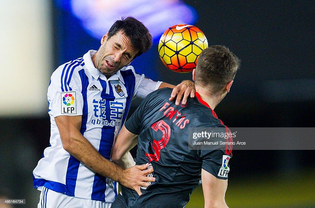 Andreu Fontas of Celta de Vigo duels for the ball with Xabier Prieto of Real Sociedad during the La Liga match between Real Sociedad de Futbol and Celta de Vigo de Futbol at Estadio Anoeta on October 31, 2015 in San Sebastian, Spain.