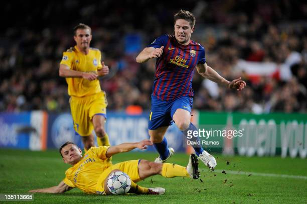 Andreu Fontas of FC Barcelona duels for the ball with Aleksandr Yurevich of FC BATE Borisov during the UEFA Champions League group H match between FC...
