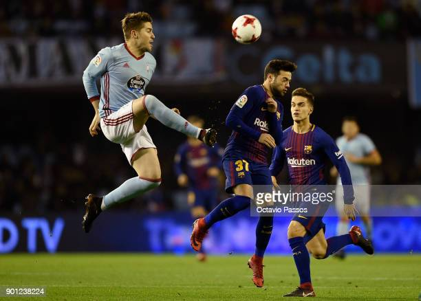 Andreu Fontas of RC Celta de Vigo competes for the ball with Jose Arnaiz of FC Barcelona during the Copa del Rey round of 16 first leg match between...