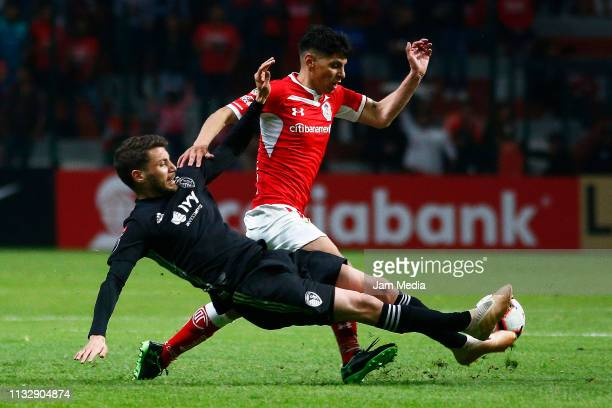 Andreu Fontas of Sporting Kansas City fights for the ball with Pablo Barrientos of Toluca during a round of sixteen second leg match between Toluca...