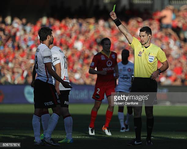 Andreu of the Wanderers is shown the yellow card by referee Jarred Gillett of the Wanderers during the 2015/16 ALeague Grand Final match between...