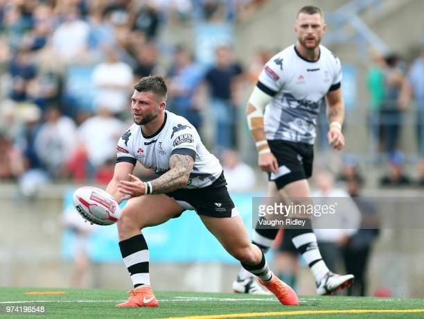 Andrew Ackers of the Toronto Wolfpack passes the ball in the first half of a Betfred Championship match against the London Broncos at Lamport Stadium...