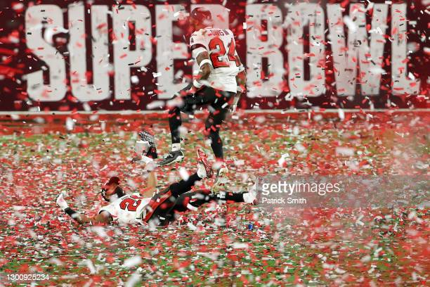 Andrew Adams and Carlton Davis of the Tampa Bay Buccaneers celebrate as confetti falls after defeating the Kansas City Chiefs in Super Bowl LV at...