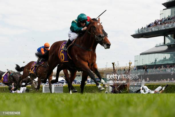Andrew Adkins riding War Baron and Glyn Schofield riding Persan fall during race 1 the Kings Of Sydney Sport Mile during The Championships Day 2 at...