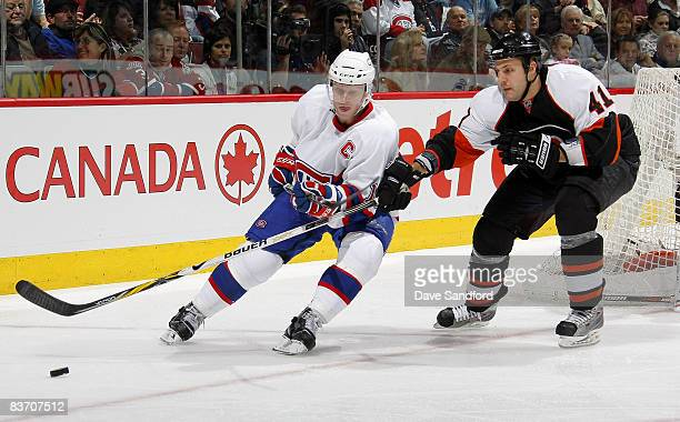 Andrew Alberts of the Philadelphia Flyers defends against Saku Koivu of the Montreal Canadiens during their NHL game at the Bell Centre November 15,...
