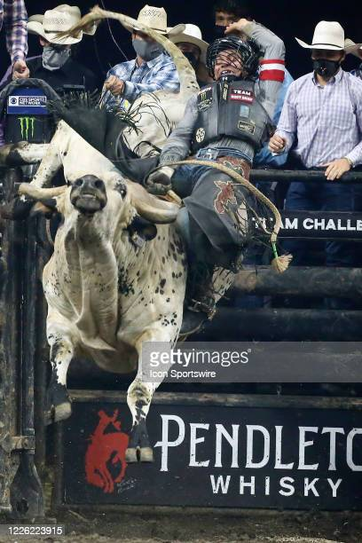 Andrew Alvidrez rides bull Marquis Metal Works Bill the Butcher during the Monster Energy Team Challenge on July 10 at the Denny Sanford PREMIER...