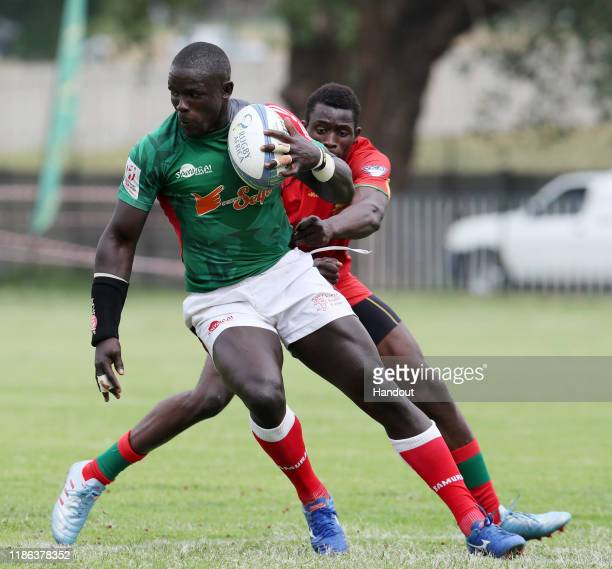 Andrew Amonde of Kenya challenged by Ibrahima of Senegal during the 2019 Rugby Africa Mens 7s match between Kenya and Senegal at the Bosman Stadium...