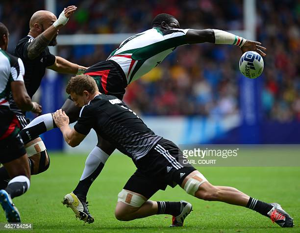 Andrew Amonde of Kenya is tackled by Scott Curry of New Zealand during the Rugby Sevens quarterfinal match between Kenya and New Zealand at Ibrox...