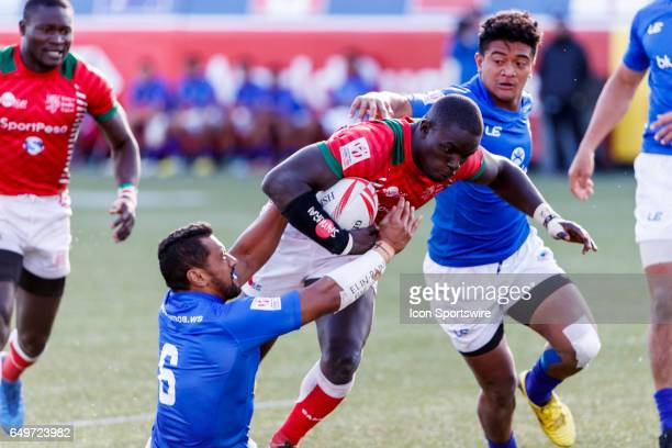 Andrew Amonde of Kenya tackled by Neria Fomai of Samoa during the Trophy Final match between Kenya and Samoa at the HSBC Rugby Sevens Series held in...