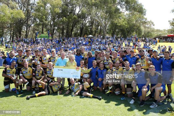 Andrew and Nicola Forrest pose with the Force after donating a cheque for $609000 to Telethon following the NRC Final between the Western Force and...