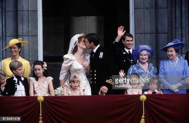 Andrew and Sarah the Duke and Duchess of York kiss on the balcony of Buckingham Palace after their wedding at Westminster Abbey Also shown are...