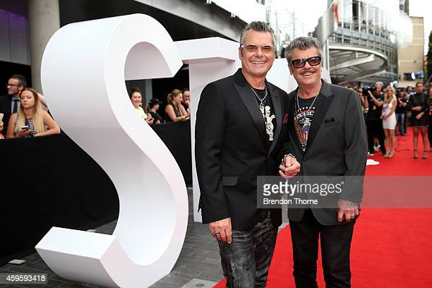Andrew and Tim Farriss of INXS arrive at the 28th Annual ARIA Awards 2014 at the Star on November 26 2014 in Sydney Australia