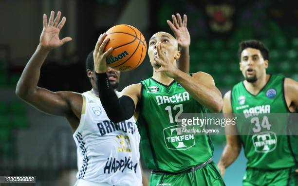Andrew Andrews of Darussafaka Tekfen in action against Nick Perkins of Happy Casa Brindisi during FIBA Champions League Group H basketball match...