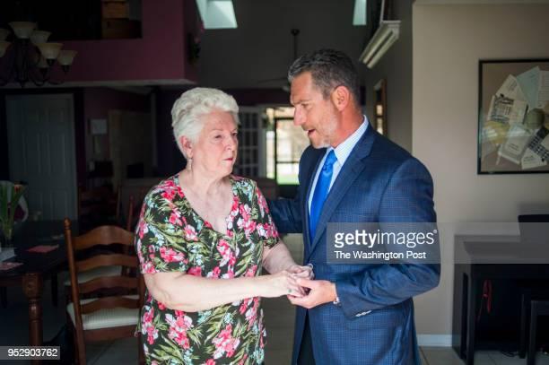 Andrew B Yaffa Doris Tyler's attorney helps guide her across the room in Doris Tyler's home in Ocoee Florida on February 9 2018 Doris was completely...