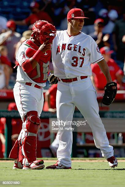 Andrew Bailey and Carlos Perez of the Los Angeles Angels of Anaheim hug after defeating the Texas Rangers 32 at Angel Stadium of Anaheim on September...