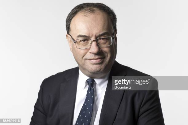 Andrew Bailey chief executive officer of Financial Conduct Authority poses for a photograph ahead of a Bloomberg Television interview in London UK on...