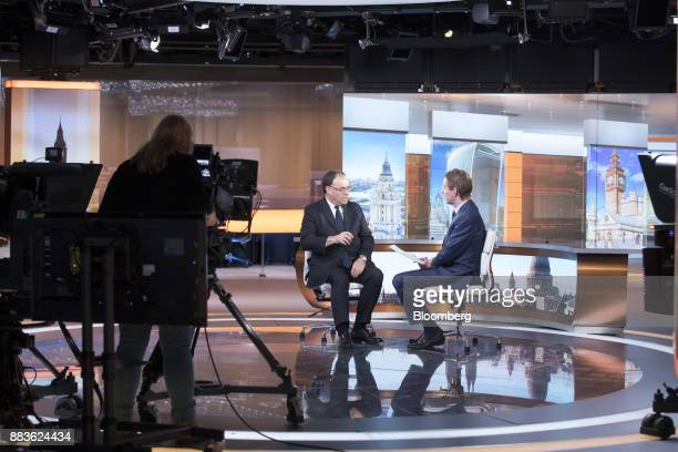 Andrew Bailey chief executive officer of Financial Conduct Authority left speaks to Mark Barton anchor for Bloomberg Television during a Bloomberg...