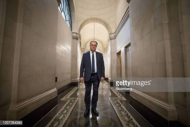 Andrew Bailey, governor of the Bank of England, poses for a photograph on his first day in the post at the central bank in the City of London, U.K.,...