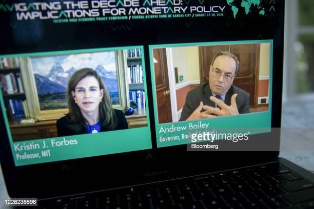 Andrew Bailey, governor of the Bank of England, right, speaks with Kristin Forbes, professor at the Massachusetts Institute of Technology , during...