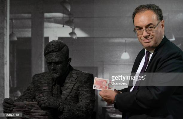 Andrew Bailey, governor of the Bank of England, with the new 50-pound banknote near a statue of World War II code breakerAlan Turing, who's image...