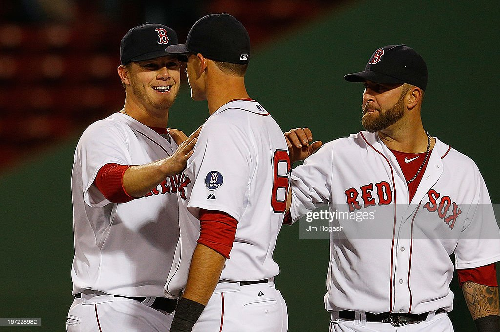 Andrew Bailey #40 of the Boston Red Sox, Will Middlebrooks #16 and Mike Napoli #12 react after defeating the Oakland Athletics, 9-6, at Fenway Park on April 22, 2013 in Boston, Massachusetts.