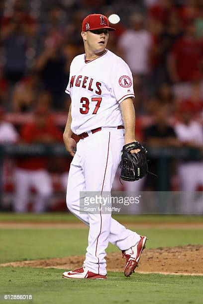 Andrew Bailey of the Los Angeles Angels of Anaheim watches a grounder during the ninth inning of a game against the Oakland Athletics at Angel...