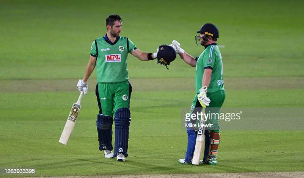 Andrew Balbirnie of Ireland celebrates reaching his century with Paul Stirling during the Third One Day International between England and Ireland in...