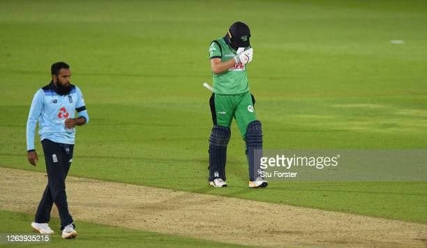 Andrew Balbirnie of Ireland walks off after being dismissed by Adil Rashid of England during the Third One Day International between England and...