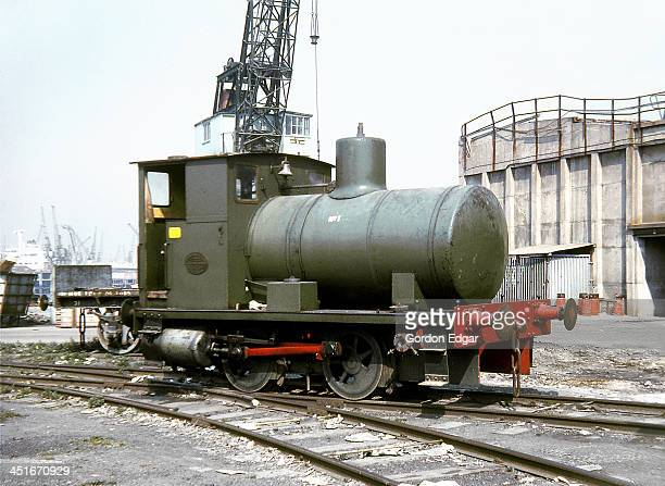 CONTENT] Andrew Barclay 040 fireless locomotive 'No1' stands on the River Thames quayside at Bowater's Northfleet Paper Mill Kent on 21st April 1971...