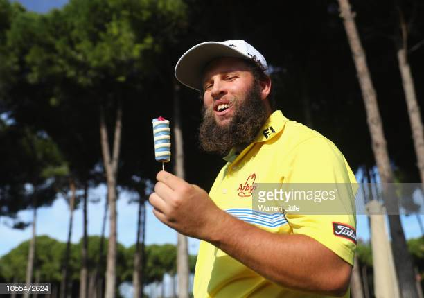 Andrew 'Beef' Johnson of England eats an ice cream during the pro am ahead of the Turkish Airlines Open at the Regnum Carya Golf Spa Resort on...