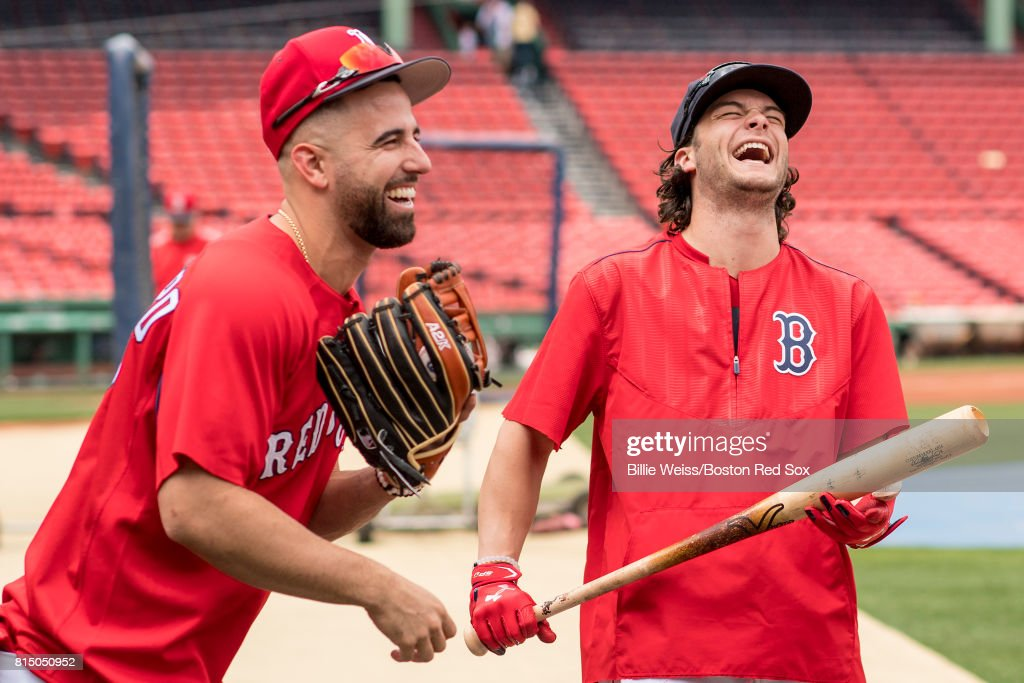Andrew Benintendi #16 and Deven Marrero #17 of the Boston Red Sox laugh before a game against the New York Yankees on July 15, 2017 at Fenway Park in Boston, Massachusetts.