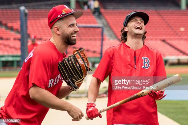 Andrew Benintendi and Deven Marrero of the Boston Red Sox laugh before a game against the New York Yankees on July 15 2017 at Fenway Park in Boston...