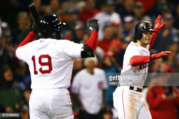 Andrew Benintendi and Jackie Bradley Jr #19 of the Boston Red sox react in the eighth inning of a game against the Chicago Cubs at Fenway Park on...
