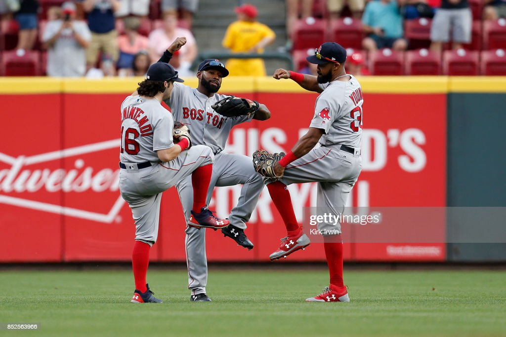 Andrew Benintendi #16, Jackie Bradley Jr. #19, and Chris Young #30, all of the Boston Red Sox celebrate after defeating the Cincinnati Reds 5-0 at Great American Ball Park on September 23, 2017 in Cincinnati, Ohio. Boston defeated Cincinnati 5-0.