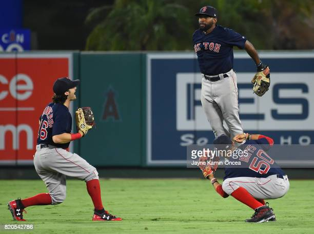 Andrew Benintendi Jackie Bradley Jr #19 and Mookie Betts of the Boston Red Sox celebrate after defeating the Los Angeles Angels in the ninth inning...
