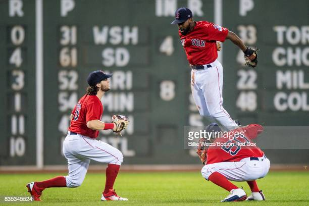 Andrew Benintendi Jackie Bradley Jr #19 and Mookie Betts of the Boston Red Sox celebrate a victory against the New York Yankees on August 18 2017 at...