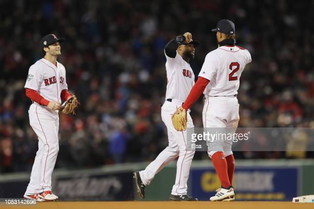 Andrew Benintendi Jackie Bradley Jr #19 and Xander Bogaerts of the Boston Red Sox celebrate their teams 42 win over the Los Angeles Dodgers in Game...
