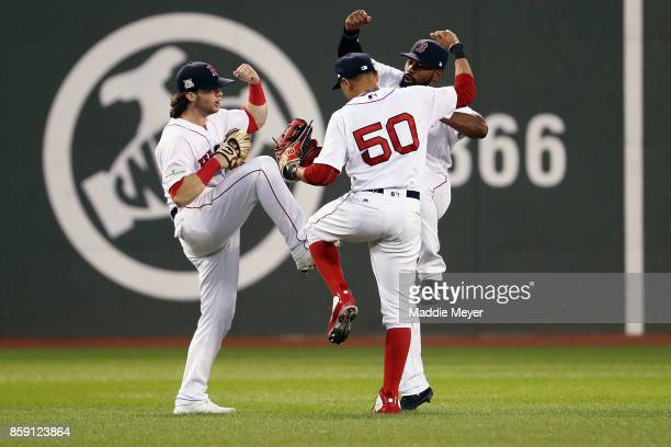 Andrew Benintendi Mookie Betts and Jackie Bradley Jr #19 of the Boston Red Sox celebrate defeating the Houston Astros 103 in game three of the...