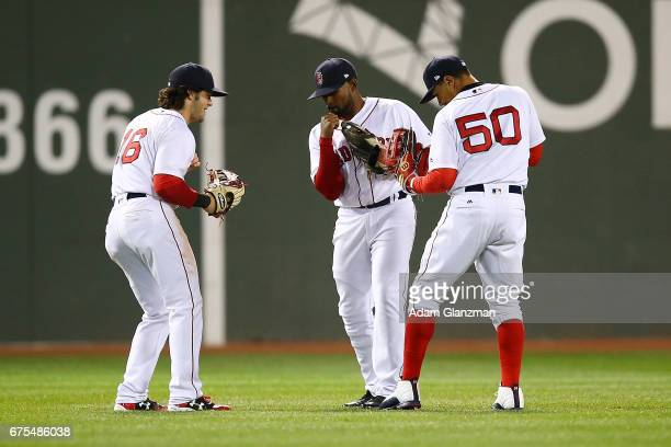 Andrew Benintendi Mookie Betts and Jackie Bradley Jr #19 react after their victory over the Chicago Cubs at Fenway Park on April 30 2017 in Boston...