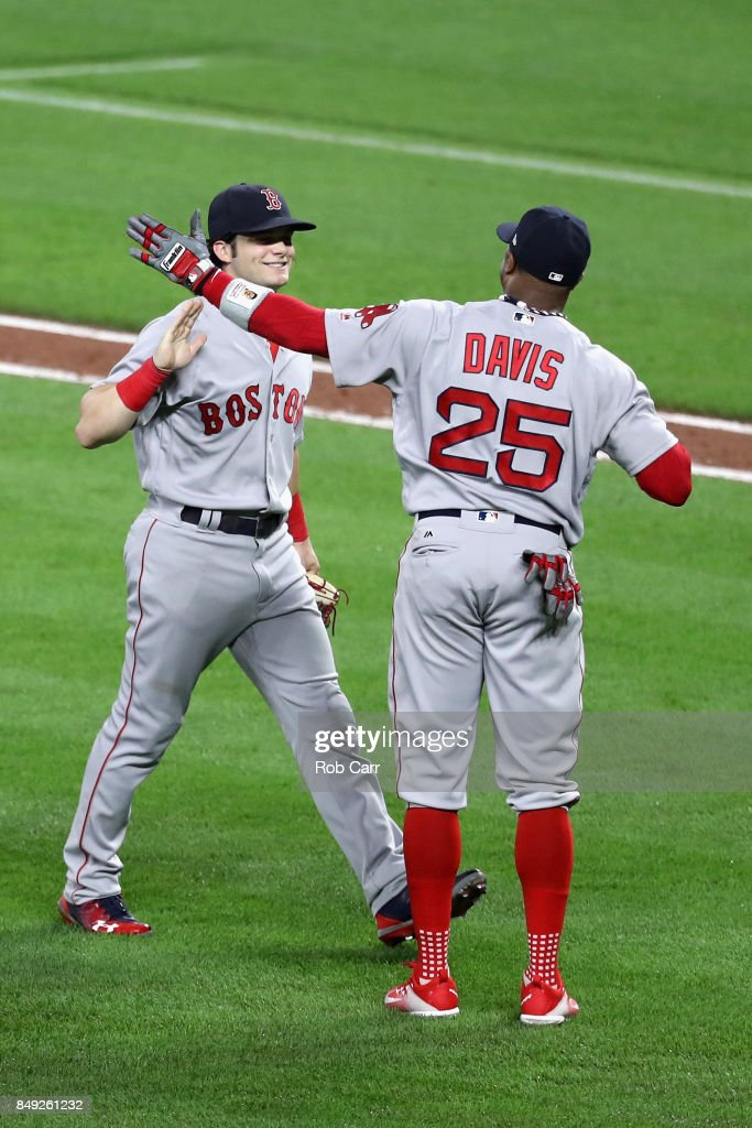 Andrew Benintendi #16 of the Boston Red Sox and Rajai Davis #25 celebrate the Red Sox 10-8 eleven inning win over the Baltimore Orioles at Oriole Park at Camden Yards on September 18, 2017 in Baltimore, Maryland.