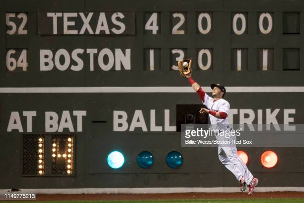 Andrew Benintendi of the Boston Red Sox catches a fly ball during the sixth inning of a game against the Texas Rangers on June 13 2019 at Fenway Park...