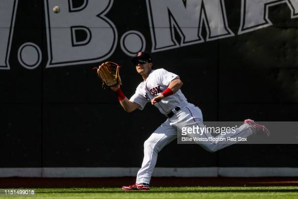 Andrew Benintendi of the Boston Red Sox catches a fly ball during the first inning of a game against the Toronto Blue Jays on June 22, 2019 at Fenway...