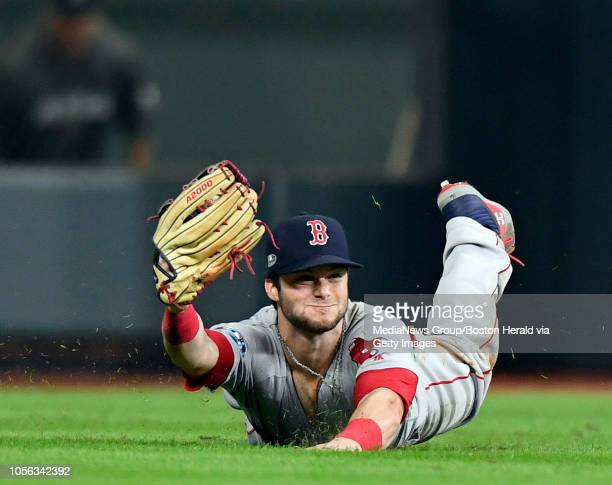Andrew Benintendi of the Boston Red Sox catches a game ending fly ball hit by Alex Bregman of the Houston Astros during the Red Sox's 86 win over...