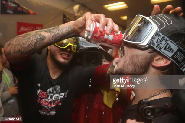 Andrew Benintendi of the Boston Red Sox celebrates in the locker room after his team's 51 win over the Los Angeles Dodgers in Game Five of the 2018...