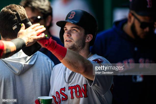 Andrew Benintendi of the Boston Red Sox celebrates scoring a run against the Kansas City Royals during the seventh inning at Kauffman Stadium on July...