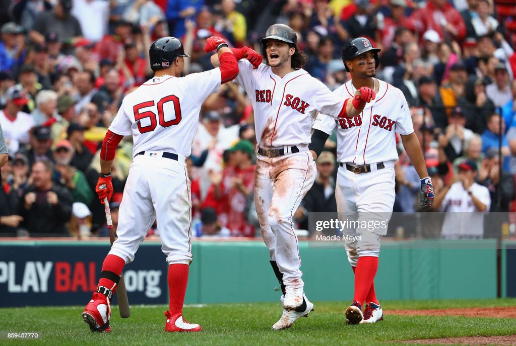 Andrew Benintendi #16 of the Boston Red Sox celebrates with Mookie Betts #50 after hitting a two-run home run in the fifth inning against the Houston Astros during game four of the American League Division Series at Fenway Park on October 9, 2017 in Boston, Massachusetts.